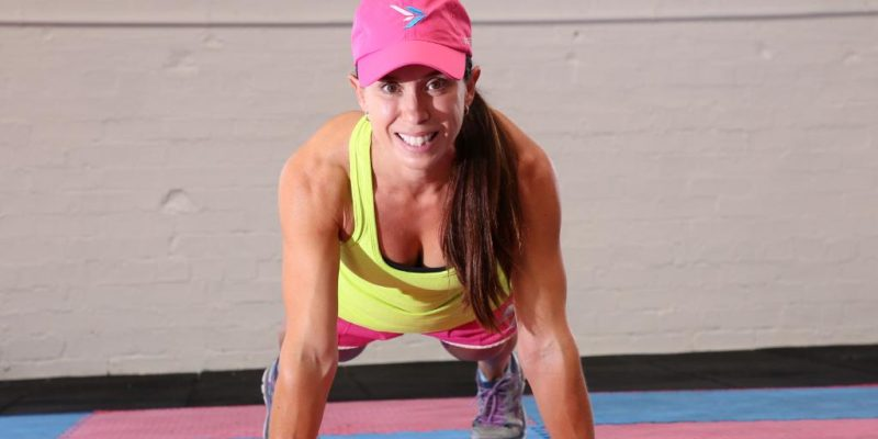 Courier Mail - Mum-of-two smashes world record as she attempts most burpees in one hour period